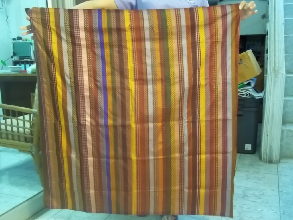 Similar to what will be unveiled at the show, this  Thai silk was woven by a microcredit client of our partner Small Enterprise Development Co. in Thailand