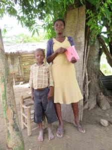 microcredit client and her child in Haiti