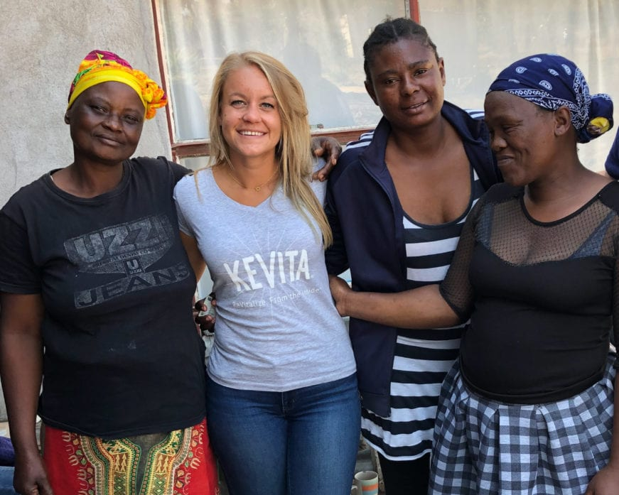 woman wearing kevita shirt with entrepreneurs in south africa